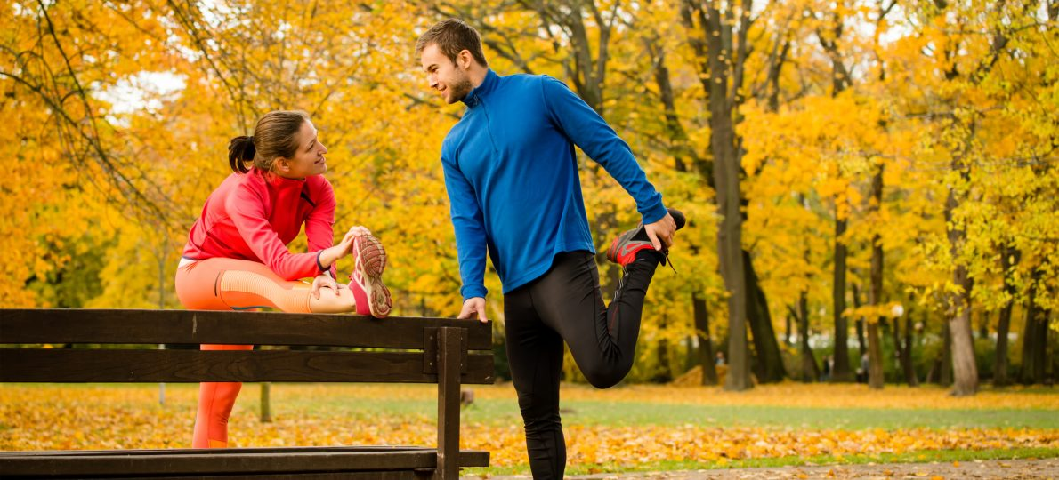 Couple stretching before jogging